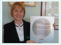 Angela Ward Holding BDA Good Practice Plaque