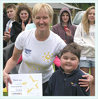 Dr Samantha Price Holding Research Trust Certificate With Disabled Boy